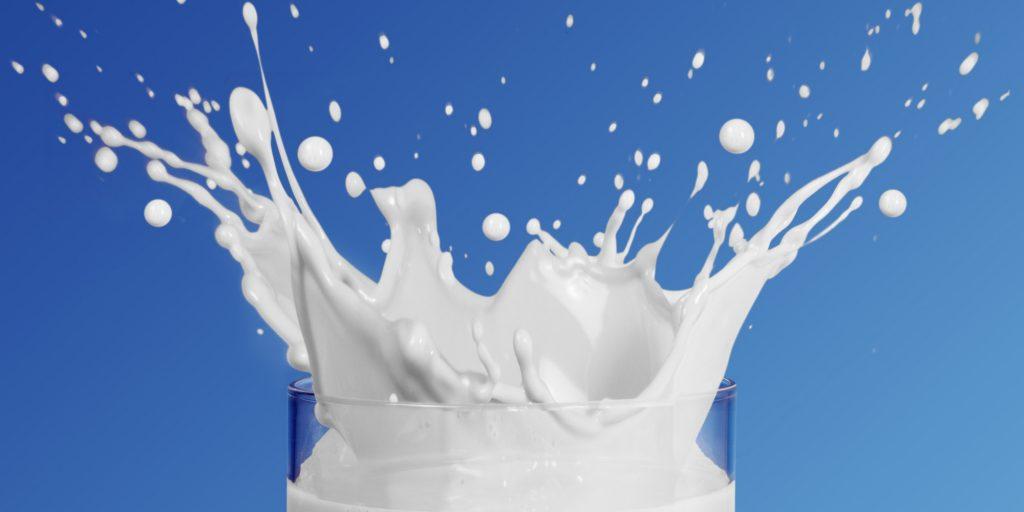 Milk splashing into glass